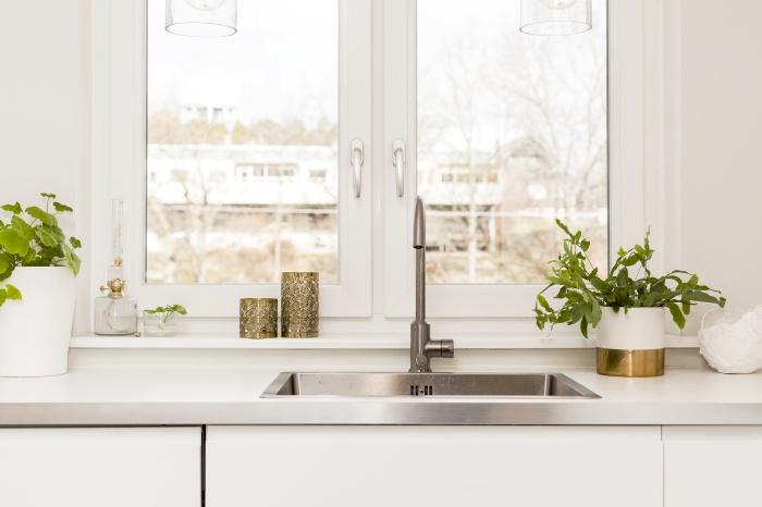 detail of a fancy kitchen sink by the window